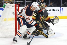 LAS VEGAS, NEVADA - OCTOBER 22:  Robin Lehner #90 of the Vegas Golden Knights defends the net against Zach Hyman #18 of the Edmonton Oilers in the first period of their game at T-Mobile Arena on October 22, 2021 in Las Vegas, Nevada.  (Photo by Ethan Miller/Getty Images)