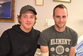 Ben Van Ginkle, right, 23, says he might not be alive today if it weren't for the quick thinking of his friend, Nick Mullally, 16. Van Ginkel lost his right hand in a farming accident on Oct. 23 in Springton. Nick rendered immediate medical aid, kept Van Ginkel from going into shock and transported him by tractor to an ambulance on the highway.