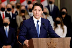 Prime Minister Justin Trudeau speaks in front of members of his new cabinet on October 26, 2021.