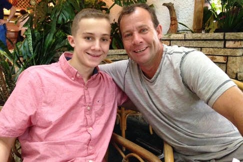 Ty with his dad, Brian Lucas, on a family trip to Banff. — Contributed photo