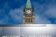 The Peace tower is seen above a welcome sign as politicians began returning to work earlier this month in Ottawa.  THE CANADIAN PRESS/Adrian Wyld