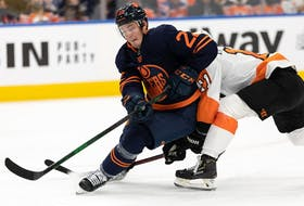 Edmonton Oilers' Tyson Barrie (22) downs Philadelphia Flyers' Travis Konecny (11) during second period NHL action at Rogers Place in Edmonton, on Wednesday, Oct. 27, 2021.