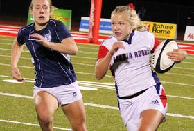 Acadia centre Emilie Merilainen breaks on the outside against St. Francis Xavier during an AUS women's rugby game Oct. 15 in Wolfville. The Axewomen will host the X-Women again in the conference championship on Sunday afternoon at Raymond Field. - JASON MALLOY / SALTWIRE NETWORK