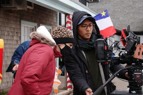 Director Kelly Caseley, left, and camera operator Oakar Myint check the framing of the next shot on the set of Aww Shucks in October 2020.