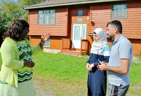 YREACH immigration settlement staff Dolores Atwood (left) talks with Alaa and Amani Almanjar outside their Shelburne home. The Almanjars are an example of a refugee family that have successfully made a small rural community home, says Atwood. Kathy Johnson