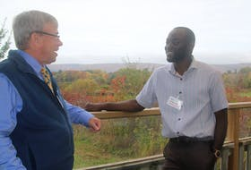 Dr. Jerry Asiedu, right, speaks with Don Hyslop after the first Mid Valley Region Physician Recruitment and Retention Committee community welcome event Oct. 23 in Bridgetown. Hyslop is the committee lead for newly formed group.