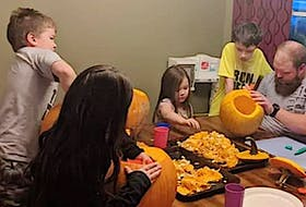 Shannon Budge, right, having fun carving pumpkins with some of his five children at an earlier date. The family of seven was left homeless following a fire in the house they were renting in Whitney Pier on Sunday night. Family and friends are rallying to help them including with a GoFundMe that has been launched. Contributed