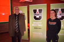 Fabian McKenzie, left, and MacKenzee Ryan are members of the Cape Breton Capers women's basketball program and were in attendance for the announcement that Cape Breton University will host the U Sports Women's Basketball Championships in March 2023. JEREMY FRASER • CAPE BRETON POST