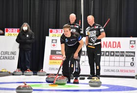 Adam Casey, third stone for the Jason Gunnlaugson rink, holds the broom during a game against Glenn Howard, back left, at the Canadian Curling Trials Direct Entry event in Ottawa in September. Casey lives in Winsloe and grew up in Seven Mile Bay. The Gunnlaugson rink, which is based in Manitoba, won its first four games at this week's 2021 Home Hardware Curling Pre-Trials event in Liverpool, N.S. Curling Canada/Claudette Bockstael
