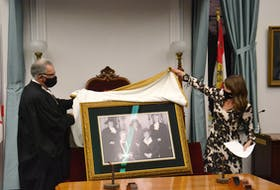 Speaker Colin LaVie and Minister responsible for the Status of Women Natalie Jameson unveil a portrait of the Famous Five, which has been permanently installed in P.E.I.'s Legislative Chamber.