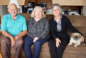 Ted Grant, left, and his wife, Rita, centre, the co-founders of Mikinduri Children of Hope, are working with Kathy Mutch, right, co-chair, on a major fundraising drive that is part of Grant's final wish. He was diagnosed five years ago with a serious lung disease that is terminal. Also pictured is the couple's dog, Snoopy, a Tibetan spaniel.