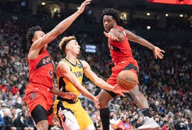 Indiana Pacers guard Chris Duarte controls the ball between Toronto Raptors forwards Scottie Barnes (left) and OG Anunoby during the second quarter at Scotiabank Arena on Oct. 27, 2021.