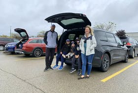 Veronica Jenik (right) and husband Dan (left) are the parents of two hockey and baseball rep players and their trusty Chrysler Pacifica (nicknamed Darth Vader) has room for all the gear and the kids to travel in sinister style. Jonathan Yarkony/Postmedia News