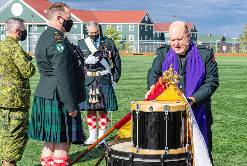 The Cape Breton Highlanders primary reserve infantry regiment of the Canadian Forces culminated a weeklong celebration of its 150th anniversary with a parade Saturday during which the Highlanders received new colours from Nova Scotia Lt.-Gov. Arthur J. LeBlanc. In the photo, Maj. Tom Hamilton, right, chaplain of 36 Canadian Brigade Group, blesses the colours at Cape Breton University. CONTRIBUTED/Master Cpl. Trevor Matheson, 5th Canadian Division Public Affairs