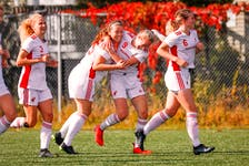 Nicole Torraville hugs teammate Holly O'Neill after the Memorial Sea-Hawks' 3-1 win over the UNB Reds in AUS women's soccer play Saturday at King George V Park in St. John's. O'Neill, who scored twice in the game, also had the Sea-Hawks' lone goal in a 1-0 victory Sunday that completed a sweep of the Reds. — Memorial Athletics/Facebook