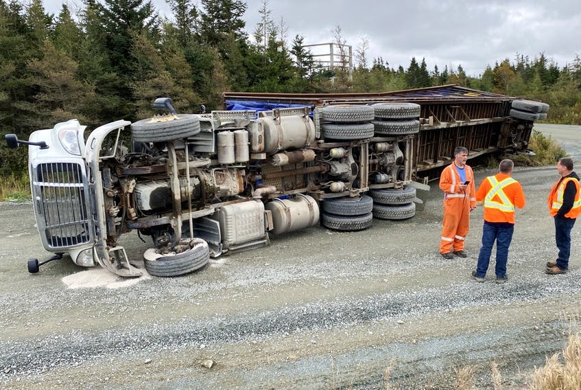 Hundreds of chickens were stuck in their cages when this truck overturned Monday morning, Oct. 4, 2021, near Cochrane Pond outside St. John's, N.L.