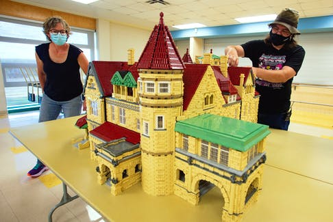Jason Pyett, owner of Playwell Bricks, shows how he can remove segments of his latest creation at the Musquodoboit Valley Education Centre on Friday, Oct. 4, 2021. The LEGO house is a replica of the Brookside Mansion at the University of Saint Francis in Fort Wayne, Indiana. Ryan Taplin - The Chronicle Herald