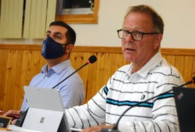 Barrington Municipal Warden Eddie Nickerson (right) and CAO Chris Frotten listen to one of the speakers at a special council meeting on Sept. 30 where the provincially mandated proof of full vaccination policy and the impact it will have for users of the local arena was the focus of discussion. KATHY JOHNSON