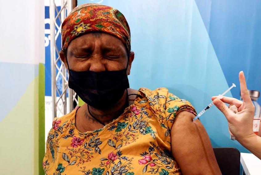 An Israeli woman receives her third dose of the coronavirus disease (COVID-19) vaccine, in Jerusalem, October 3, 2021.
