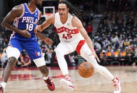 Toronto Raptors guard Dalano Banton drives to the basket against Philadelphia 76ers guard Shake Milton during their pre-season game.