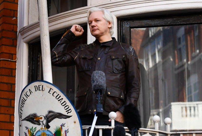 In this file photo taken in 2017 Wikileaks founder Julian Assange speaks on the balcony of the Embassy of Ecuador in London.