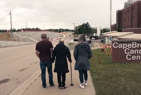 Left to right, Tim and Cayla Toomey along with daughter Haley, head into the Cape Breton Cancer Centre in Sydney where Cayla received treatment before her death on March 17, 2021. Contribute