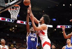Toronto Raptors forward Justin Champagnie shoots against Philadelphia 76ers forward Paul Reed.