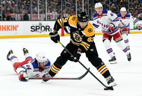 Boston Bruins centre Brad Marchand controls the puck against New York Rangers defenceman Matthew Robertson during the first period of Friday's NHL pre-season game at the TD Garden in Boston. - Brian Fluharty-USA TODAY Sports