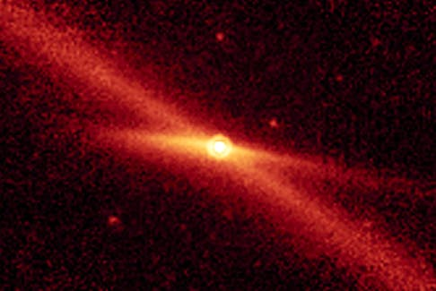 This image, taken by NASA Spitzer Space Telescope, shows the comet Encke riding along its pebbly trail of debris along a diagonal line between the orbits of Mars and Jupiter. - NASA