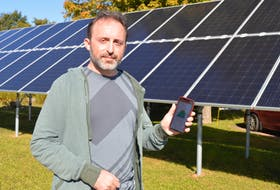 Jeremy Ladan of Charlottetown recently had solar panels installed outside his home through the Switch Charlottetown program to reduce his electric bills. He's able to measure the amount of energy those panels put out via an app on his smartphone.