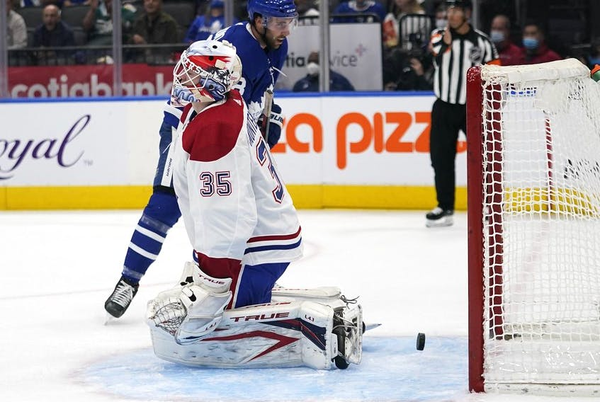 A shot by Maple Leafs forward Nick Ritchie eludes Canadiens goaltender Samuel Montembeault during the first period Tuesday night at Scotiabank Arena in Toronto.