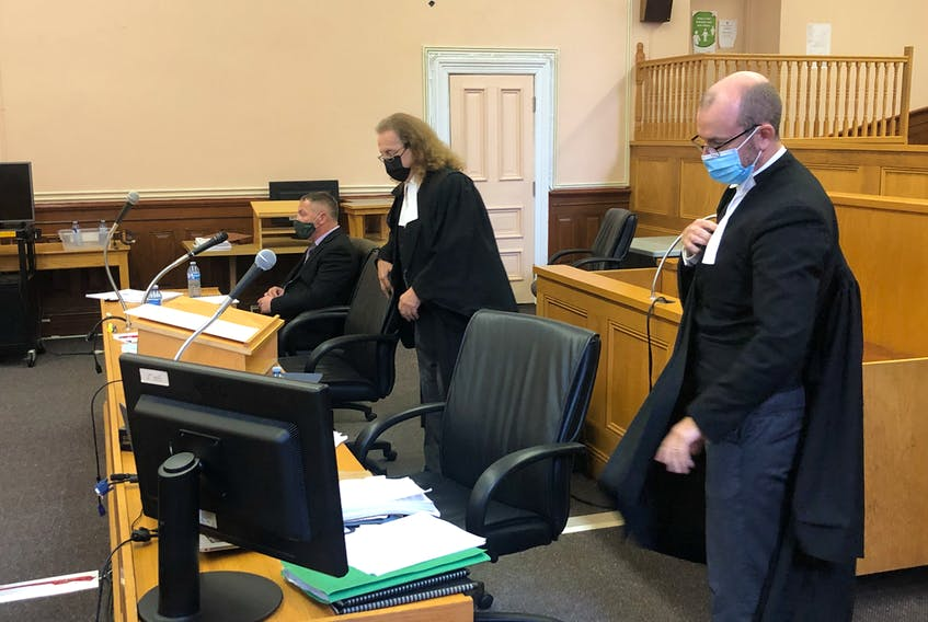 George Pottle (seated), defence lawyer Bob Buckingham and prosecutor Jeff Summers (foreground) prepare for court to resume after a break in Pottle's trial in Newfoundland and Labrador Supreme Court in St. John's on Tuesday, Oct. 5. TARA BRADBURY • THE TELEGRAM