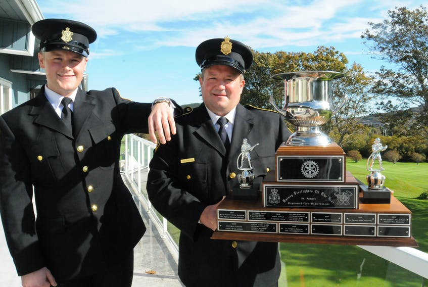 St. John's Regional Fire Department (SJRFD) firefighter F/Lieut. Greg Parsons (right) was named the Rotary Club of St. John's 2021 Firefighter of the Year during a Rotary Club luncheon at the Bally Haly Country Club on Wednesday afternoon, Oct. 6. The award is presented each year during Fire Prevention Week in October. Standing with Parsons after Wednesday's presentation is his son, Zachary, a firefighter with the SJRFD for the past two years. Joe Gibbons • The Telegram