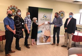 Florrie Barrett willed $100,000 to the Glace Bay Hospital Foundation. Barrett's nephews Hugh MacKay and Keith MacKay were at the Glace Bay Hospital on Thursday to present the hospital foundation with the cheque. From left are James Kerr, Michelle MacNeil, John MacIntyre, foundation chair Cathy Power, Keith MacKay and Hugh MacKay.