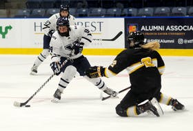 Maggy Burbidge of the St. Francis Xavier X-Women skates into the Dalhousie Tigers' zone during an AUS women's hockey exhibition game earlier this month. Burbidge joined St. F.X. after Robert Morris University in Pennsylvania axed its hockey programs in May. - BRYAN KENNEDY / ST. F.X. ATHLETICS