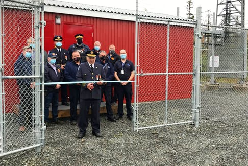 John Davison, Regional Emergency Management Coordinator for Pictou County cuts the ribbon on a new telecommunication tower in the Blue Mountain area.