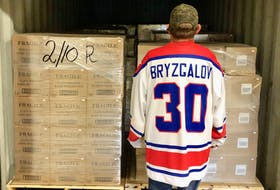 An unidentified employee at the Glenora Distillery had some fun as he donned a Russian hockey jersey while shipping pallets were loaded with product headed for Russia. The jersey is that of former NHL goalie Ilya Bryzgalov, who has not officially endorsed the product. CONTRIBUTED