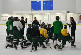 UPEI Panthers head coach Forbie MacPherson, right, explains a drill during a practice earlier this week. The Panthers open the 2021-22 Atlantic University Sport men's hockey regular season at MacLauchlan Arena on Oct. 8 against the UNB Reds. The opening faceoff is 7 p.m.