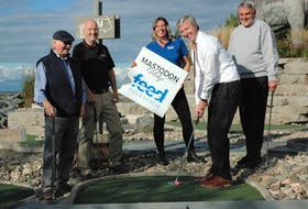 Nova Scotia Premier Tim Houston lines up his putt to kick-off a weekend of golf proceeds, at Mastodon Ridge Mini-Golf course, going towards area food banks. Pictured along with Houston are Mastodon Ridge owner Bill Hay (left), Mayor of Stewiacke George Lloy, director of communications with Feed Nova Scotia Karen Theriault, and Colchester-Musquodoboit Valley MLA Larry Harrison.