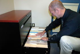 In this 2007 photo, RCMP Const. Gordie Matthews, of the Northern Region Major Crime Unit, looks through the files that have been generated by the investigation into the murder of Amherst resident Sadie Rogers in 1981. The entire filing cabinet is filled with documents related to the case, but police are no closer to solving the crime and are asking people's assistance in helping them solve it.