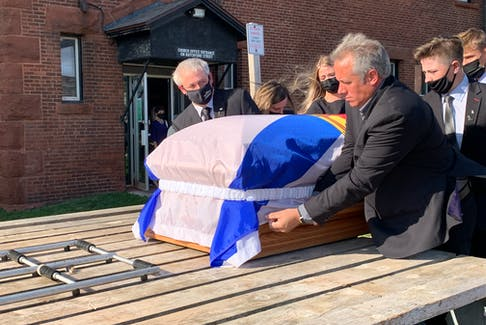 The casket for late premier Roger S. Bacon is lifted on a hay wagon following his funeral at Trinity-St. Stephen's United Church in Amherst. The former premier was eulogized Friday as a humble man who always put people and the agricultural community first. Darrell Cole – SaltWire Network