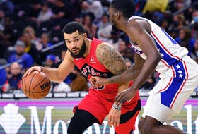 Raptors' Fred VanVleet (left) drives to the basket against Philadelphia 76ers' Shake Milton during the second quarter at Wells Fargo Center on Thursday, Oct. 7, 2021.