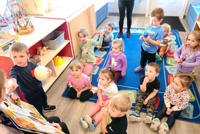 Logan Levangie shows his classmates at Town Daycare a real ostrich egg in this photo from earlier this year. The three-year-old early learners were learning about ostriches that day and their teacher was reading them a book about the birds. The other students are, front row from left, Alexis MacKinnon, Holly Younger, Owen O'Leary, behind them from left, Brielle MacIntosh, Scarlett Rideout, John-Thomas King, Miley Popwell, behind them from left, Ryan Doyle, A.J. Lockman, Lainey MacIntosh and William Coolen is sitting behind Lockman. CONTRIBUTED