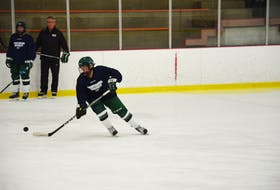 Ally Clements of the UPEI Panthers looks to control the puck during a practice earlier this week. Team manager Don MacFadyen and Stephanie Leger look on. The Panthers host the Mount Allison Mounties in their 2021-22 Atlantic University Sport women's hockey home opener at MacLauchlan Arena on Oct. 9 at 7 p.m.
