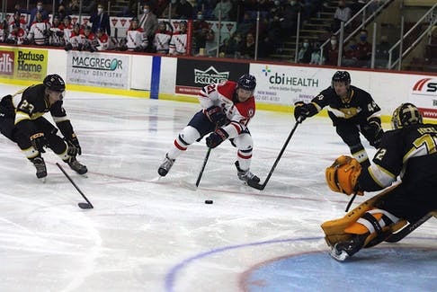 Acadia Axemen captain Garrett McFadden uses a backhand to beat Dalhousie Tigers goalie Connor Hicks for his first goal of the 2021-22 season.