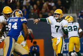 Edmonton Elks quarterback Trevor Harris (7) throws against the Winnipeg Blue Bombers in Winnipeg on Friday, Oct. 8, 2021.