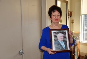 Anne MacPhee holds a photo of her late husband, Kelly. MacPhee, who lives near the Armdale roundabout in Halifax, about six minutes away from a hospital, says she called for an ambulance for her husband on Sept. 29, 2020, but it took nearly 40 minutes for help to arrive. By that time, Kelly MacPhee had passed away in her arms.
