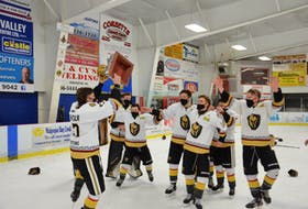 Charlottetown Bulk Carriers Knights captain Max Chisholm hoists the P.E.I. major under-18 hockey championship trophy. The Knights defeated the Kensington Monaghan Farms Wild 9-2 in Kensington on Saturday night to sweep the best-of-seven series.