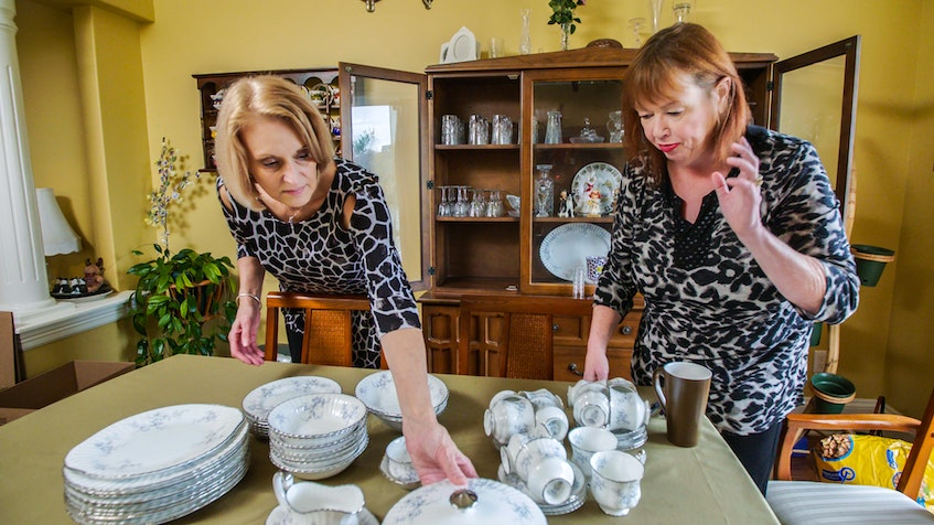 Professional organizer Jane Veldhoven helps Susan Sparks decide if she wants to hang on to a china set she rarely uses in season three of The Big Downsize, airing Mondays on Vision TV. - Tell Tale Productions