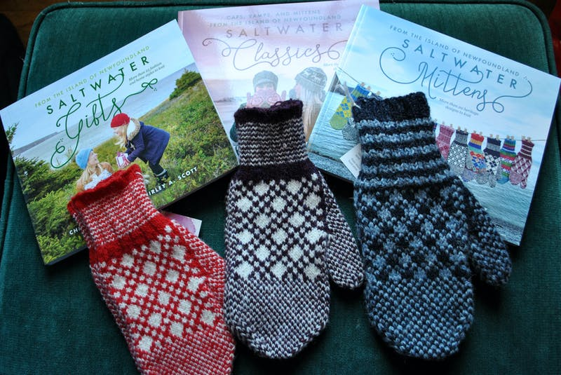 Mittens made from patterns in the Saltwater knitting series books are popular retail items in the Barrington Museum Complex giftshop. KATHY JOHNSON